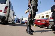 A Nigerian policeman patrols the Murtala Muhammad Specialist Hospital in Kano, Nigeria on Wednesday, December 5, 2012. A police officer directing traffic was killed when a roadside bomb exploded near his intersection in Kano earlier in the week.