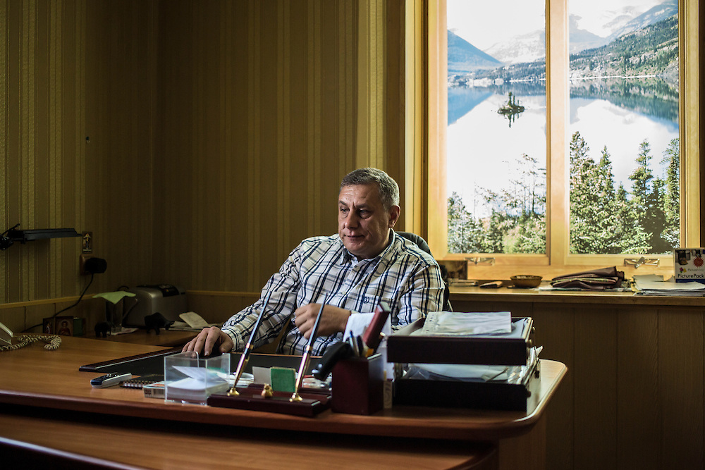 Oleg Zinchenko, a local businessman who has been helping people displaced by fighting in Eastern Ukraine, sits in his office on Wednesday, October 15, 2014 in Berdyansk, Ukraine. Photo by Brendan Hoffman, Freelance