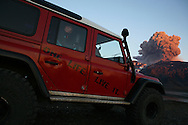 Continuing activity of Eyjafjallajokull volcano attracts viewers in late evening when lava spewing can be seen glowing orange. Eruption spews tephra that forms an ash cloud that drift toward continental Europe. 10 May 2010.<br /> &copy; Etienne de Malglaive.