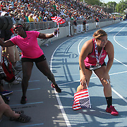 BINGSON - 13USA, Des Moines, Ia.  - While fellow hammer thrower Amber Campbell (third place) still was working the crowd, winner Amanda Bingson ran out of gas during their victory lap.    Photo by David Peterson