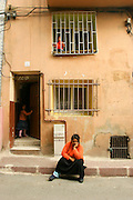 Turkey, Istanbul, A mother and her children in the Balat neighborhood in Istanbul, Turkey.