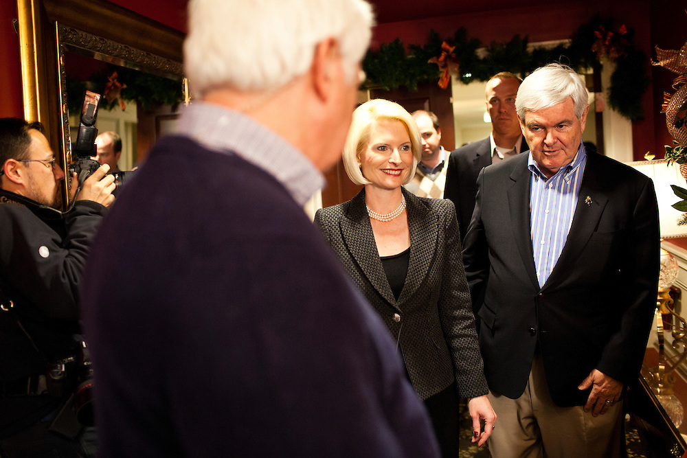 Republican presidential candidate Newt Gingrich, right, and his wife Callista Gingrich, walk to a media availability after speaking at a Rotary Club meeting on Tuesday, December 27, 2011 in Dubuque, IA.
