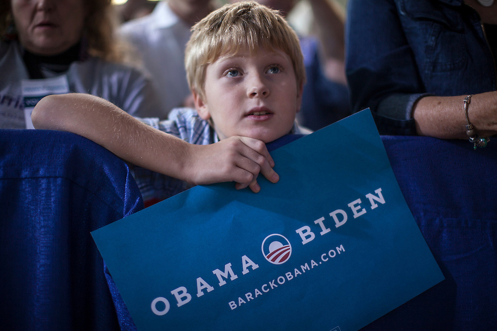 Davis Hamilton, age 9 of Grinnell, listens as Vice President Joe Biden speaks at a rally at Grinnell College during a two-day campaign swing through Iowa on Tuesday, September 18, 2012 in Grinnell, IA.