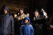 H. Demetrius Bonner leads a prayer for victims of gun violence outside Mayor Emanuel's house on December 21, 2016.