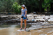 BOULDER, CO - SEPTEMBER 13: A local resident walks past 26th and Topaz Streets in Boulder, Colorado as heavy rains for the better part of week fueled widespread flooding in numerous Colorado towns on September 13, 2013. (Photo by Marc Piscotty/ © 2013)