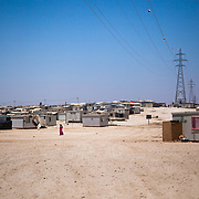 Since the camp opened three years ago, it has developed from a tent only community to almost completely caravans. While the caravans provide more protection from the harsh desert environment, they are sweltering during the summers and tend to leak in the winters.  Zaatari Camp for Syrian Refugees, Jordan, July 2015.