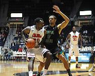 "Ole Miss' Nick Williams (20) vs. Coastal Carolina's Warren Gillis (0) at the C.M. ""Tad"" Smith Coliseum in Oxford, Miss. on Tuesday, November 13, 2012."