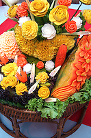 One of the best things about Thai cuisine is that not only is the food tasty and healthy, but beautifully presented.  One reason for this is the art form of fruit and vegetable carving.  No, that is not a rose, it is a tomato!