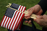Free American flags were passed out before the 85th Annual Memorial Day services at Veterans Memorial Cemetery at Evergreen Washelli. <br />