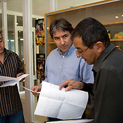 Helmy Abouleish, (c) Managing Director of the leading Egyptian Organic foods and products producer, Sekem Group, meets with managers in an office at the Sekem farm Nov 4, 2008 in Belbeis, Egypt. Helmy's father, Dr. Ibrahim Abouleish founded the project in 1977 on what was then barren desert, and since has grown it into a lush oasis ecompassing several farms, production plants, schools and even a local medical facility.