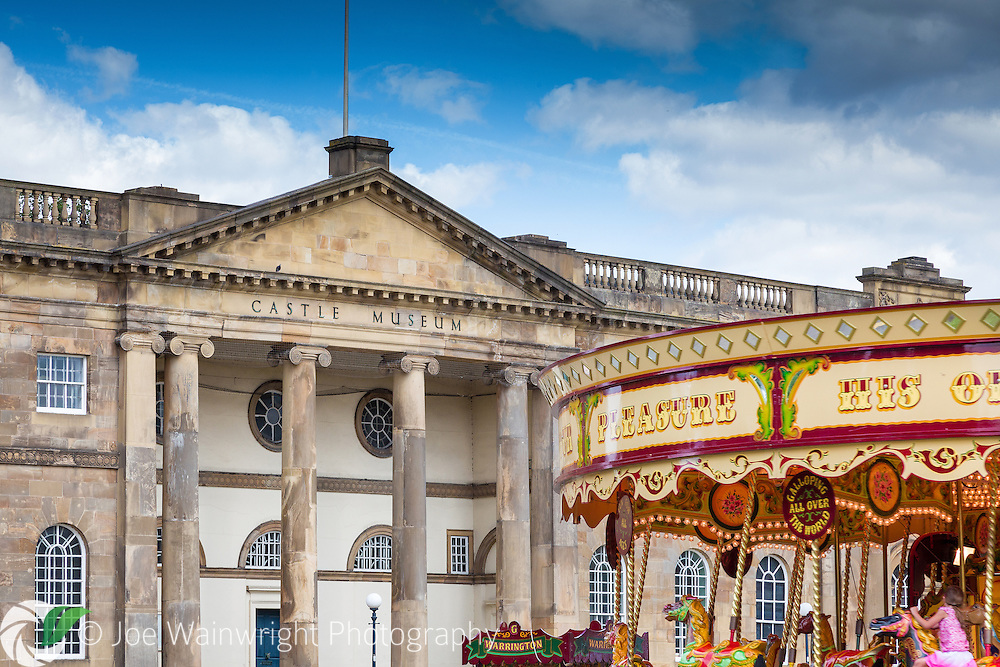 A merry-go-round is an attraction to younger visitors, outside York's famous Castle Museum.