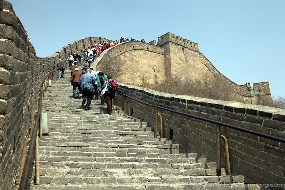 Asia, China, Beijing. Visitors climbing steps at the Great Wall