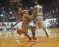 "Ole Miss guard Chris Warren (12) loses the ball at the C.M. ""Tad"" Smith Coliseum in Oxford, Miss. on Wednesday, February 9, 2011. Ole Miss won 66-60 and is now 4-5 in the Southeastern Conference."