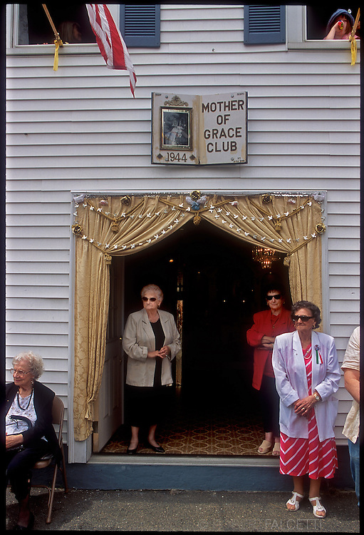 GLOUCESTER, MA- JUNE 29, 2003:  Members of the Mother of Grace Club wait for the Archbishop of Boston to arrive during the annual celebration paying homage to St. Peter, the patron saint of fishermen in Gloucester, MA. The festa takes place on the weekend closest to the Feast Day of St. Peter, June 29. .(Photo by Robert Falcetti) . .