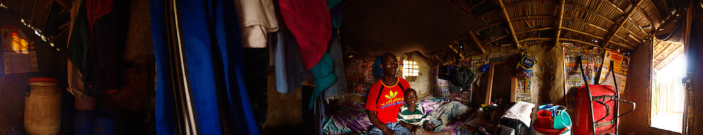 Junior and his son Godgave at home. Junior lost his wife in labour as well as five of his children from various illnesses. Godgave, 4,  is now his only child, Freeman Reserve, Liberia.