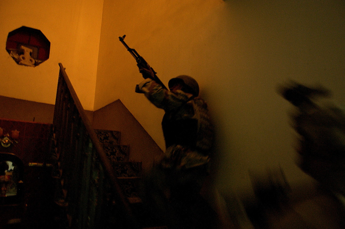 Soldiers from the 3rd Battalion, 1st Brigade, 7th Infantry Regiment Iraqi Army, search a house during Operation Touchdown in Jazeera, Ramadi, Iraq. Operation Touchdown is a joint raid on five targeted houses by U.S. soldiers from 1st Battalion, 6th Infantry Regiment and Soldiers from the 3rd Battalion, 1st Brigade, 7th Infantry Regiment Iraqi Army in order to capture/kill Anti Iraqi Forces (AIF) in Jazeera, Ramadi. Twelve AIF were detained, one AIF was killed in action (KIA), and one Iraqi Army soldier KIA. — © TSgt Jeremy Lock/