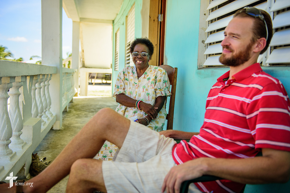 The Rev. Duane Meissner, career missionary to Belize, chats with Ina at her home, one of his regular stops during his walks in the village, on Wednesday, Sept. 28, 2016, in Seine Bight, Belize. LCMS Communications/Erik M. Lunsford