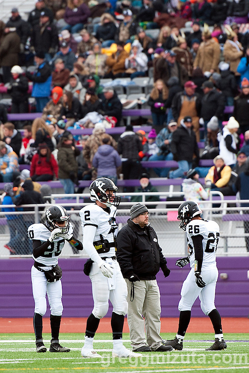 Vale's Austin Amick, Derek Hiatt, coach Nate Aldred, and Rudy Gomez before the start of the 3A Championship game against Santiam Christian at Kennison Field, Hermiston, Oregon, Saturday, November 28, 2015. Vale won 27-20.