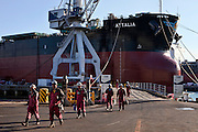 Workers leaving from the ship ATTALIA after a day's work.