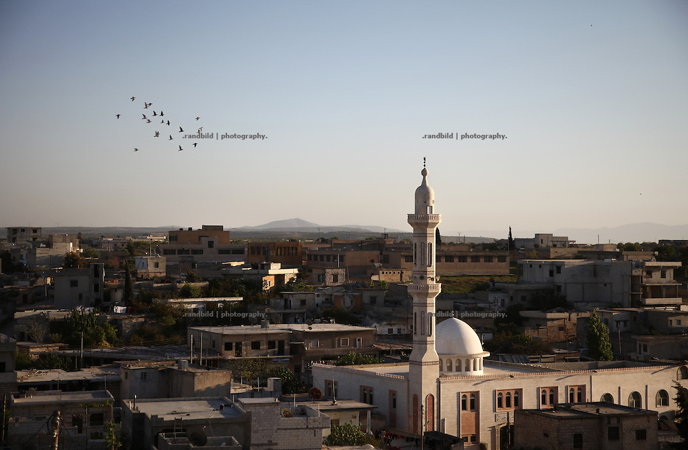 General view and mosque in Koreen. Koreen was been attacked by ground troops on February 22, 2012 (see archive images). Since then artillery shelled regularly and halicopters dropped barrel bombs several times into the village counting a few thousend inhabitants south of Idlib city. Korren is still a stronghold of opposition.