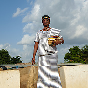 "Pognaa Dogkudome Tegzuylle I of Lyssah within the complex of the Paramount Chief in Lawra in the Upper West Region of Ghana on 28 June 2015. The term ""pognaa"" is the feminine equivalent of ""naa"", or chief. A pognaa is responsible, in particular, for the wellbeing of women and children in her area of authority. While the title translates as ""woman chief"", in practice her authority is  subject to a male chief. The role of the pognamine (plural of pognaa) is being revived after having been suppressed during the colonial era, and they are increasingly seen as a force for development."