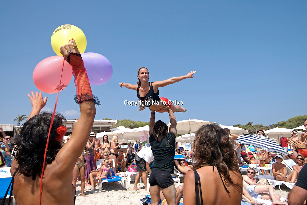 "Sexy attractive young people doing acrobatics as a promotion of Pacha´s David Guetta F""""ck me Im famous party in Salinas beach, Ibiza, Spain - Photo by Nano Calvo"