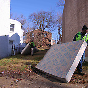 Donnel Ricketts (RIGHT) and Bill Freeborn (LEFT) seen removing old mattresses from an abandoned lot during The Delaware Valley Development Company Inaugural Trash to Cash event Monday, Jan 19, 2015 in Wilmington, Del.
