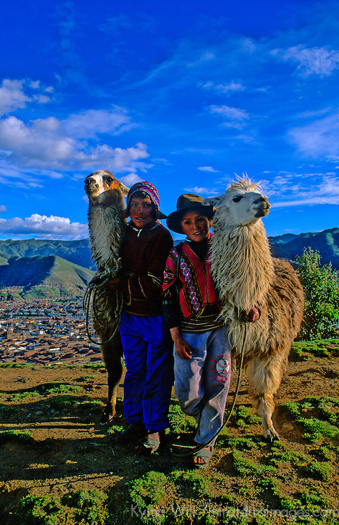 South America, Peru. Guardians of the llamas