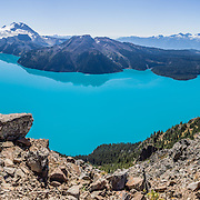 From stunning Panorama Ridge, admire the vibrant turquoise color of Garibaldi Lake, which comes from glacial flour suspended in meltwater from Sphinx and Sentinel Glaciers. Garibaldi Provincial Park is east of the Sea to Sky Highway (Route 99) between Squamish and Whistler in the Coast Range, British Columbia, Canada. A hiking loop to Garibaldi Lake via Taylor Meadows Campground is 11 miles (18k) round trip, with 3010 ft (850m) gain. Panorama Ridge is 6 miles (10k) RT with 2066 ft (630m) gain from either Taylor Meadows or Garibaldi Lake Campground (or 17 miles RT with 5100 ft gain from Rubble Creek parking lot). This panorama was stitched from 10 overlapping images.