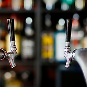 SHOT 6/26/09 3:36:21 PM - A pair of chilled beer taps at LoHi Steakbar in Denver, Co. The neighborhood bar and restaurant features fresh mixology drinks and affordable food options. (Photo by Marc Piscotty / © 2008)