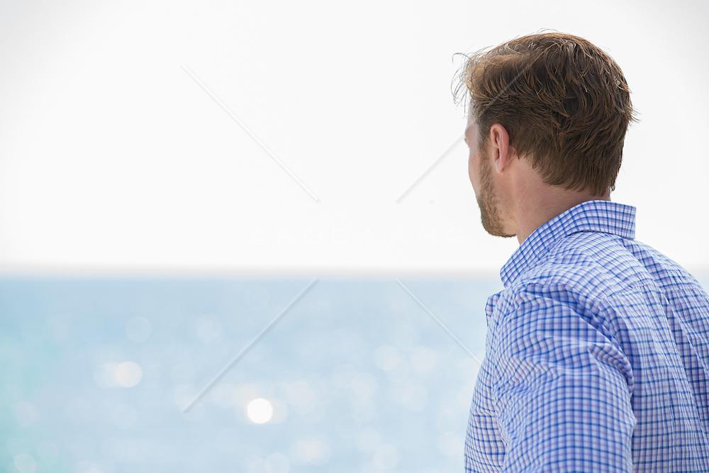man looking at the ocean