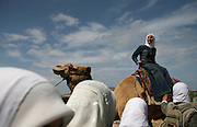 A Palestinain school girl rides a camel during a school outing at an amuzement park where the former Jewish settlement of Netzareem used to be .The rival Palestinian factions Hamas and Fatah installed their new unity government on Saturday, hoping the alliance will end months of infighting and persuade the international community to lift a year of economic sanctions. (Photo by Heidi Levine/Sipa Press).