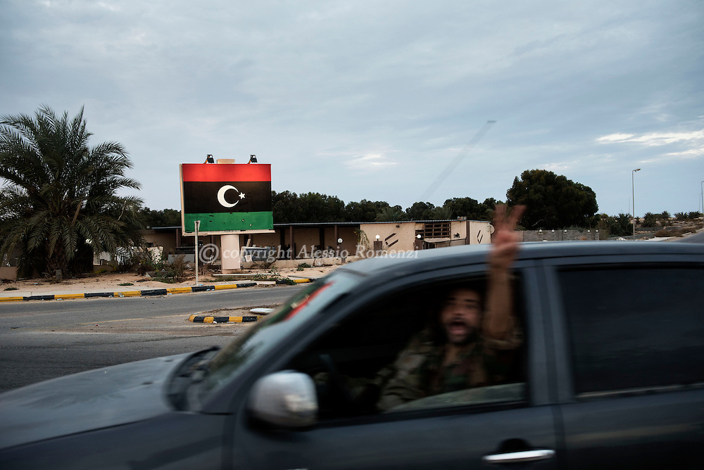 Libya, Sirte:  on November 25, 2016, a fighter of the Libyan forces affiliated to the Tripoli government flashes the &quot;V&quot; of victory as he drives in Zafaran square.<br />