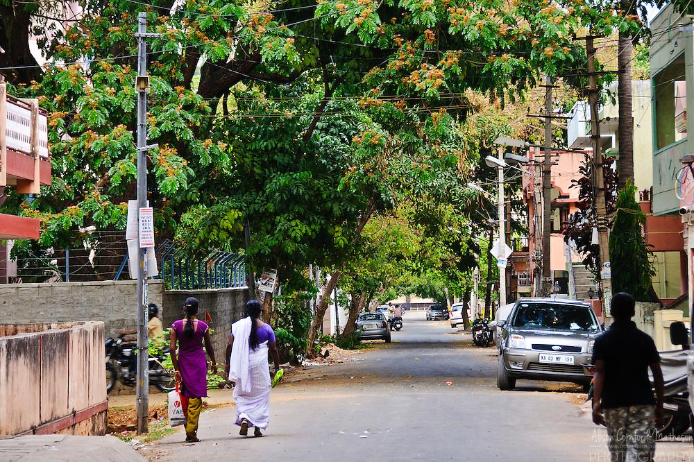 Women walk home on Bangalore India's green streets.