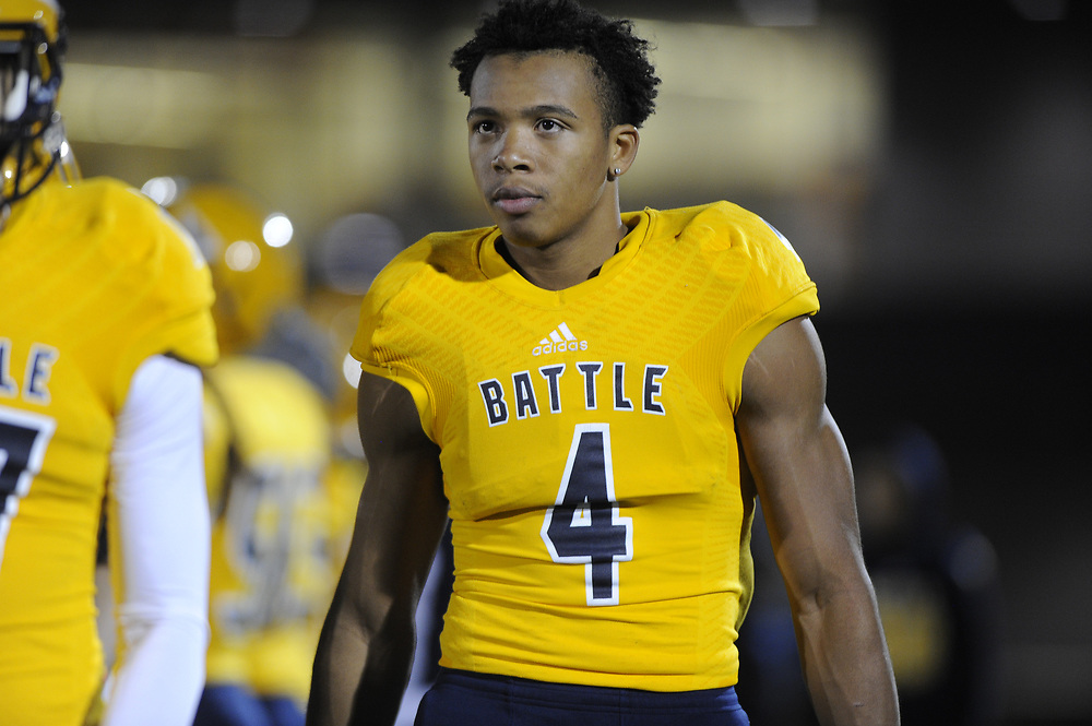 Junior wide receiver Jaevon McQuitty stands on the sidelines after scoring a touchdown for Battle during the third quarter of their home game against Hannibal on Friday night, October 16, 2015.  Battle ran a 12-play drive of 80 yards to score.