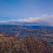 The full moon rises over Waimea Canyon on the Hawaiian island of Kauai. Waimea Canyon, 10 miles long and 3,500 deep, is known as the Grand Canyon of the Pacific.