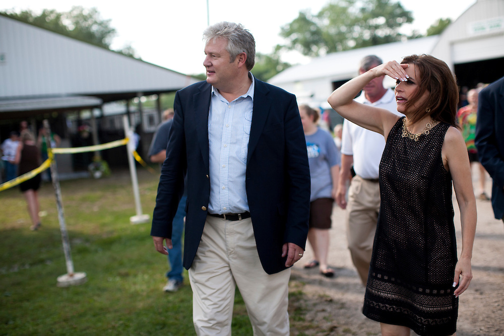 Republican presidential hopeful Michele Bachmann and her husband Marcus Bachmann, left, during a campaign stop at the Story County Fair on Saturday, July 23, 2011 in Nevada, IA.