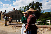 Williamsburg, VA - October 5, 2010: Megan Brown and Deidre Jones assume their positions as actor-Interpretors in Colonial Williamsburg, Virginia on Tuesday, October 5, 2010.<br /> <br /> (Photo by Matt Eich/LUCEO for The Washington Post)