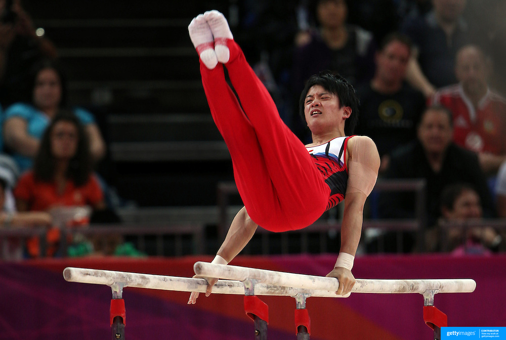Yusuke Tanaka, Japan, in action in the Men's Parallel Bars Final at North Greenwich Arena during the London 2012 Olympic games London, UK. 7th August 2012. Photo Tim Clayton