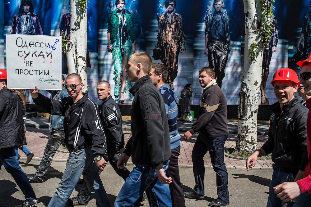 DONETSK, UKRAINE - MAY 7: A group of miners marches to the regional administration building, which is occupied by pro-Russian protesters, to support a movement for greater autonomy from the government in Kiev on May 7, 2014 in Donetsk, Ukraine. Tensions in Eastern Ukraine are high after pro-Russian activists seized control of at least ten cities and ahead of the Victory Day holiday and a planned referendum on greater autonomy for the region. (Photo by Brendan Hoffman/Getty Images) *** Local Caption ***