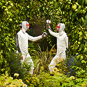 LONDON, UK - 21 May 2012: fencers from the British Fencing Team clash swords at the 'Hillier Nurseries & Garden Centres' stand at the RHS Chelsea Flower Show 2012.