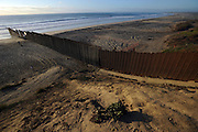 Tijuana Mexico ..the border in Playa Tijuana..While working on this long term project 'La Frontera' I want to examine the cultural and humanitarian activities on both sides of a border that keeps the United States and Mexico apart with a wall of steel already 600 miles long. The turf wars of drug cartels, arms trafficking and rampant kidnappings turned cities like Tijuana into some of the most dangerous places on earth. Despite the violence many brave artists, photographers, architects, poets, humanitarians, teachers etc live and work in the shadow of the wall on both sides and have a positive influence on this region; they are the focus of my long term project along the border. (Over time I plan to cover the entire length from the Atlantic to the Pacific, these images were taken in and around Tijuana).© Stefan Falke