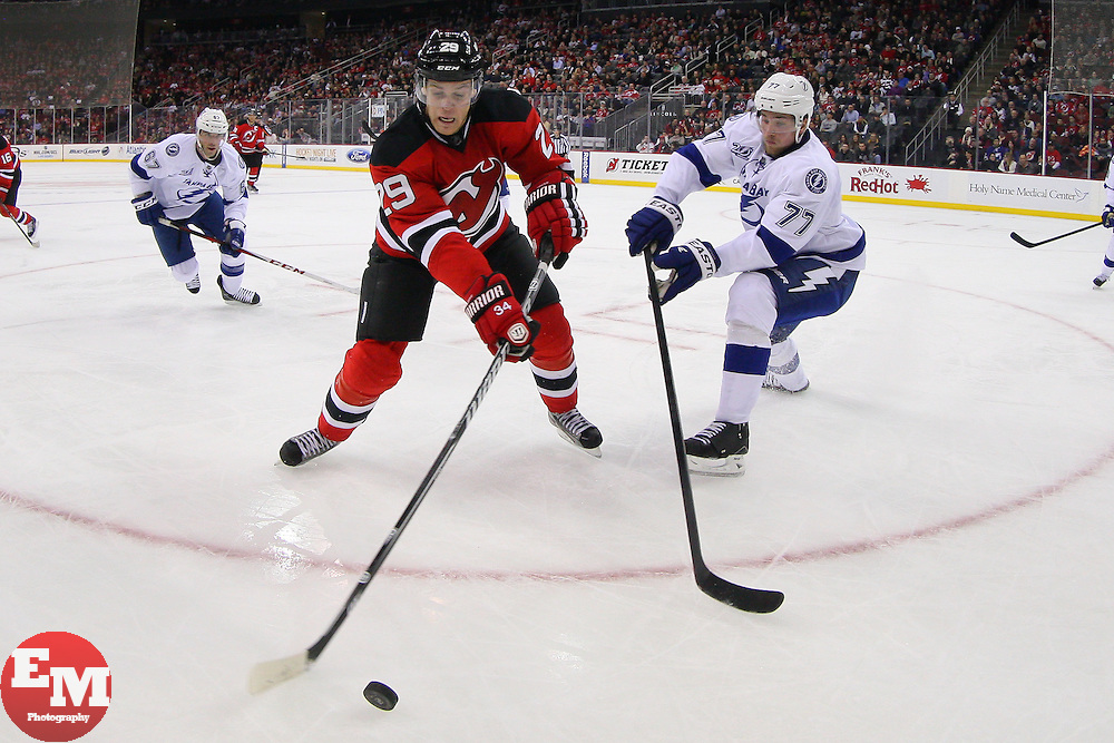 Feb 7, 2013; Newark, NJ, USA; New Jersey Devils defenseman Mark Fayne (29) and Tampa Bay Lightning defenseman Victor Hedman (77) battle for the puck during the second period at the Prudential Center.