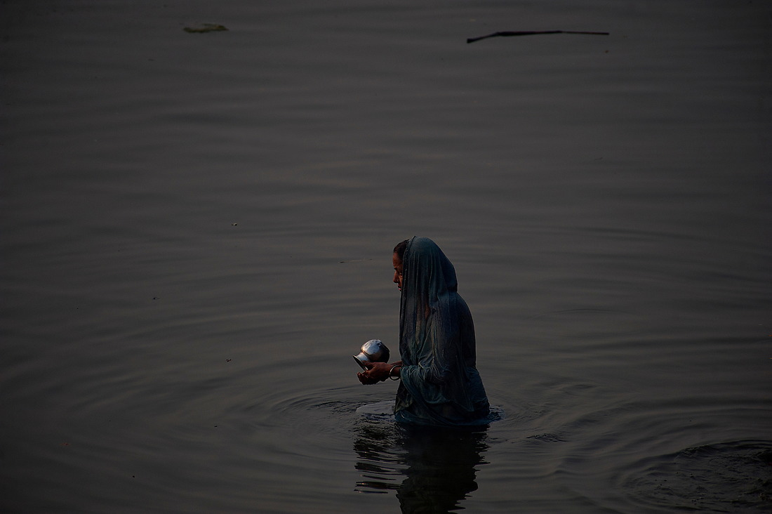 A woman collects water from the Ganges after bathing on January 31, 2013 in Varanasi, India. — © Jeremy Lock/