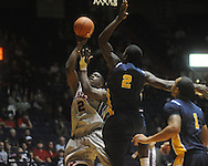 "Ole MIss forward Reginald Buckner (2) shoots as Murray State forward Edward Daniel at the C.M. ""Tad"" Smith Coliseum in Oxford, Miss. on Wednesday, November 17, 2010."