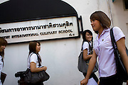 "Wittaya Jannoi (21) in the university campus after finishing with the day's classes. He is a .marketing student and hopes to change his gender after he finishes his studies at Suan Dusit .university.  He sais: ""I'm happy here. We can be ourselves because we don't have to hide. My .mother said, 'Graduate first, then you can do what you want'."" Like many transgender students, he .learnt about the university through the beauty pageant. ""I couldn't wait to come here."".In Suan Dusit University in Bangkok, ladyboys feel free to be themselves by getting dressed in .girls' uniforms and behaving in a feminning way. The University's policy of accepting them as .equal to other students, has made it so popular that it now has about 100 transgender students .studuing in it's faculties."