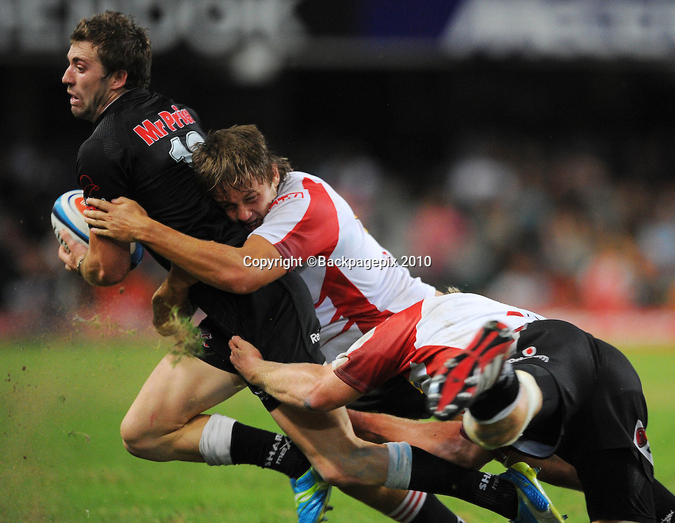 Tim Whitehead of the Sharks tackled by Stephan Greeff of the MTN Golden Lions and Franco van der Merwe of the MTN Golden Lions <br /> &copy;Chris Ricco/Backpagepix