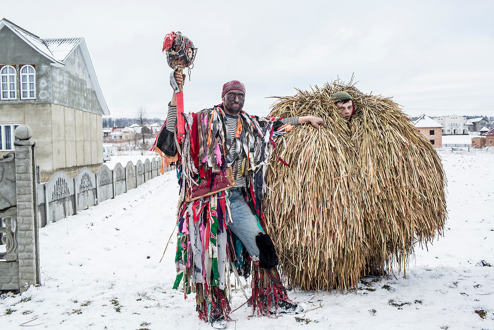 Revelers in the costumes of a gypsy, left, and bear, pose for a portrait during celebrations of the Malanka Festival on Thursday, January 14, 2016 in Krasnoilsk, Ukraine. The annual celebrations, which consist of costumed villagers going in a group from house to house singing, playing music, and performing skits, began the previous sundown, went all night, and will last until evening.