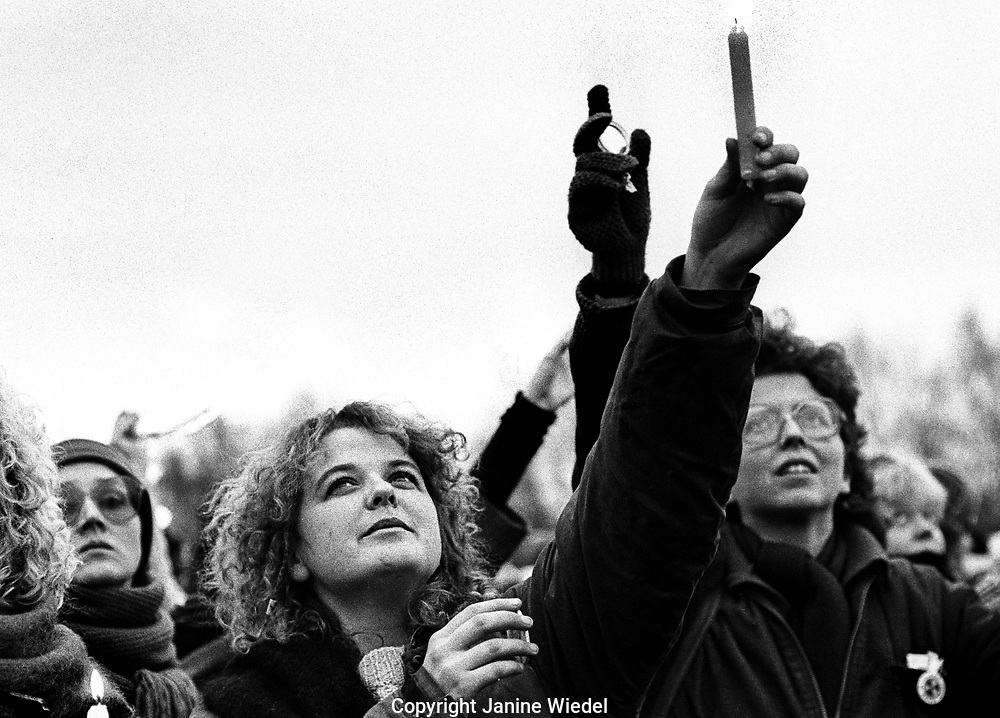 Candles being held up at protest action at the anti-nuclear Greenham Common Women's Peace Camp in 1983 / 1984. The women only camp surrounded the RAF  base in Berkshire (UK) where American cruise missiles were being stored.
