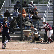 Caravel Academy Catcher Kiera Swank (21) makes contact with the ball during of a varsity scheduled game between Caravel Academy and The Delmar Wildcats Saturday, April 4, 2015, at Caravel Athletic Field in Bear Delaware.